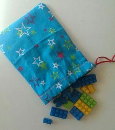 Drawstring bags of building blocks for Operation Christmas Child shoeboxes