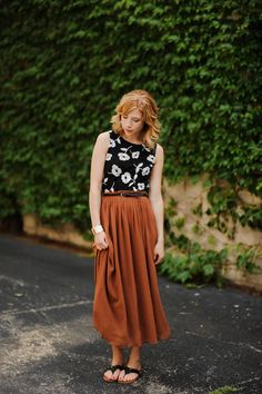 This looks so cool, with the long earthy boho skirt & this sleeveless flower-print blouse! // Happiness.
