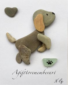 """Little puppy"" this little guy turned out to be one of my favorites! So I need to come up with a name for him! Any suggestions? #agifttorememberart #pebbleart #puppy #dog #artwork #handmadeart #etsy #etsyshop #makersgonnamake #madebyme #nature #instaart #instaphoto #frame #interiordesign #love #dogperson #cutepuppy #craft #stones #recycledart #giftideas #australia #unique #artistsofinstagram"