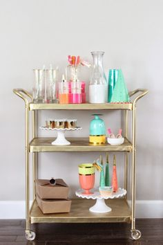 Summer bar party cart. Thrifted bar cart painted gold.
