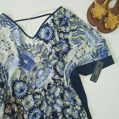 NWT Floral Print Poncho Top w/ Cold Shoulder NWT Navy/Lt. Blue/Lt. Yellow/White floral print with navy trim. Polyester. Flows beautifully. A. Byer Tops