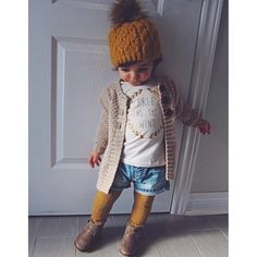 Tights, shorts & boots. Saw a little girl wearing this, a white broderie top and a chunky mustard cardigan.