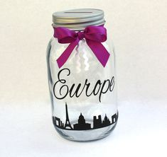 This Europe jar is the perfect way to save for that trip you have always wanted to take! It is a quart size glass mason jar with an aluminum coin