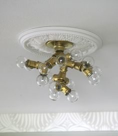 DIY ceiling fixture by Little Green Notebook Diy Kitchen Projects, Diy Projects, Small Hallway Decorating, Little Green Notebook, Diy Light Fixtures, Diy Workshop, Ideias Diy, Wood Lamps, Ceiling Medallions