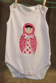 Babushka - I think this type of applique design would make a cute heated rice bag.