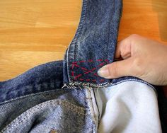 How to make an old-school purse out of worn out jeans! I hand sewed mine (however if you have a sewing machine definitely use it!) and finished it off with a polka dot ribbon around the former waist of the jeans. Gets me lots of compliments! ;)