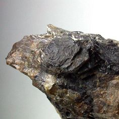 Keiviite-(Y), Y2Si2O 7,  Høgtveit, Evje Og Hornnes, Aust-Agder, Norway. Black aggregates of the very rare Keiviite-Y sitting in feldspar