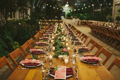 Garfield Park Conservatory Wedding, Feasting tables with garland, photo by Galaxie Andrews