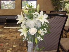 Chair/Aisle decoration with lilies and roses.