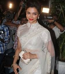 """Saree paired up with the well stitched blouse is a head turner for sure. Here is a list of High Neck Saree Blouse Designs"""" worn by actress Deepika Padukone. Blouse Designs High Neck, Designer Blouse Patterns, Fancy Blouse Designs, Saree Jacket Designs Latest, High Neck Kurti Design, Neckline Designs, Dress Designs, High Neck Saree Blouse, White Saree Blouse"""