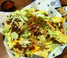 """Buffalo Wild Wings' so-called """"Ultimate Nachos.""""   A bed of chips, Texas chili, pico de gallo, shredded lettuce, jalapenos, queso, and salsa.   http://ilovenachos.tumblr.com/post/5637380549/buffalo-wild-wings"""