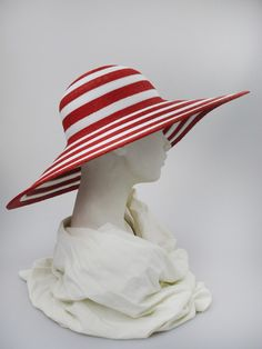 Wide-brimmed hat (side view) | Label: Philip Treacy | Red and white braided and sewn fine straw wide-brimmed hat. Summer wear | Made in England