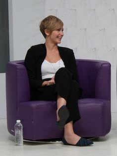#JenniferLawrence cracks a smile while visiting #Yahoo HQ to chat #THG #CatchingFire