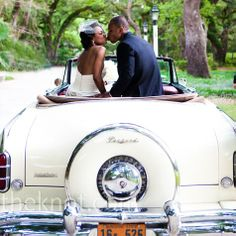 Guests blew bubbles as the couple made their exit in a vintage white Packard.