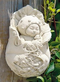"""Cast Stone Garden Baby Pixie Fairy Plaque - Indoor / Outdoor Concrete Sculpture by Creative Structures. $36.95. Unique And Whimsical Works Of Art By George At Carruth Studio. Dimensions: 4"""" W x 6.5"""" H x 2.5"""" D - Item Weight: 2.5 Lbs. - Made In The USA. Hand Cast Stone, Weatherproof & Waterproof, Handfinished With A Patina Wash To Accentuate The Details. A Copper Hook Is Embedded In The Back For The Hanging Of This Piece. Extremely Innovative Creations That Breathe Life..."""