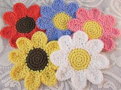 Daisy Coasters. Quick and easy to crochet. Check out my blog for a link to the free pattern. They are Daisy Coasters by Deni Speigle on Ravelry. http://yarnpumpkin.blogspot.com/2014/02/crocheted-daisies-and-spring-fever.html