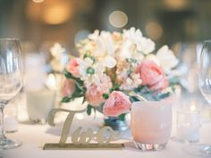wedding table setting with pink details from Borrowed & Blue