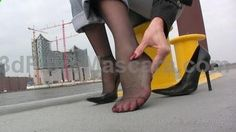 Nadja waiting for a ship in the harbor if hamburg city.She walk up and down at the pontoon in her black high heels.Hear the sound of her heels on the ground :-) Nadja sit down to relax her feet from the shoes.Thats the chance to get a view on her black pantyhosed soles.In the background you can see the Elbphilharmonie one of the most expensive buildings in hamburg! www.clips4sale.com/13625/5592237 #pantyhose #sexy #ladies #women #ladyproducts #lush #smooth #fashion #stunning #legs #glamour