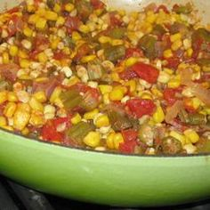 "Okra, Corn and Tomatoes   ~  ""Okra and onions are fried with bacon, then simmered with tomato and corn in this delicious side dish that is especially good served alongside cornbread. This recipe is a longtime family favorite."""