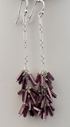 Sterling silver chain earrings made with Czech Glass Bugle beads. No two pair are identical. $40.00 a pair.