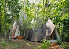 Hiroshi Nakamura's Nasu Tepee home features a cluster of timber-clad peaks mingling with the trees