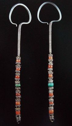 Mongolian Jewelry -- Suike style earrings attach with rings that go over the ear or attach to the hair and headdress. This is because the size & weight of these earrings is beyond what a pierced ear lobe can hold Tribal Jewelry, Metal Jewelry, Boho Jewelry, Jewelry Art, Antique Jewelry, Silver Jewelry, Jewellery, Silver Ring, Wire Earrings