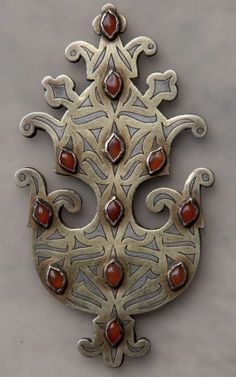 Turkmen | Pendant; Silver with gold wash details, and carnelian stones.