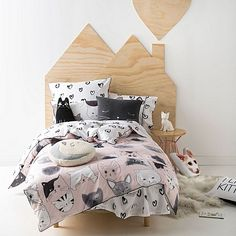 Inspire their sleep with the hand-drawn design on the Kitty Cat Quilt Cover Set from Hiccups.