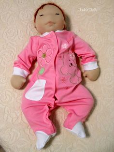 Life size Waldorf inspired baby doll. She is filled with wool and her skin is made of highest quality Turkish combed cotton interlock. Face is made using needle felting technique and eyes are embroidered with cotton thread. Hair is made of mohair yarn.  She comes with pink romper and polka dot undies.