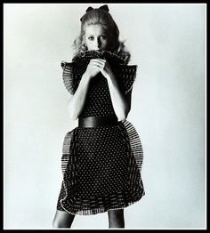 Catherine Deneuve in pinafore-pleat-rimmed dress by Lanvin, photo by David Bailey, Vogue March 1, 1968