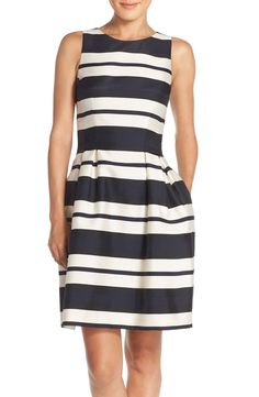 Bold stripes give this gorgeous dress a modern feel. Just add a bright statement necklace for a unique touch.