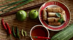 Setting vegetable and Spring roll plate on bamboo basket background, Vietnamese food, vintage style Food concept footage