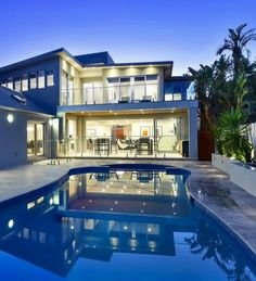 Modern Contemporary House Design with large windows and great backyard.
