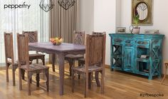 This rustic look with a six seater dining with beautiful carved legs and a matching finished blue side cabinet is the perfect dining spot for your home. The metal wired ceiling lamps gives it a slight contemporary look.