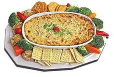 smoked salmon and artichoke dip  Preheat oven to 350°  1 package (8 oz) Cream cheese, softened   1 cup Mayonnaise   1 tsp Worcestershire sauce   1/2 cup chopped Smoked salmon   1/3 cup chopped Onions   1 can (14 oz) chopped Artichoke hearts   1/2 cup shredded Parmesan cheese   2 tbsp chopped Parsley (or 2 tsp dried parsley