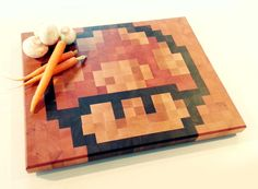 Endgrain chopping board with retro gaming pixel art by JJProducts, $149.00
