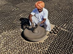 A potter makes diyas in preparation of the upcoming Diwali festival in Jodhpur