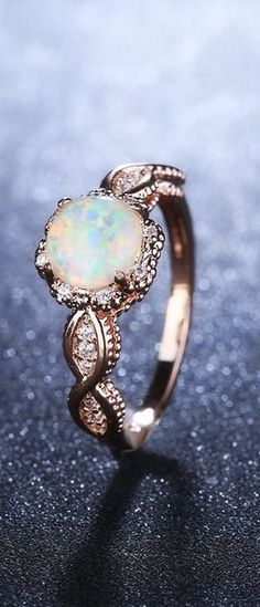 this beautiful Virant opal rose gold ring, you'll add a true note of class and elegance to each or your oufits.With this beautiful Virant opal rose gold ring, you'll add a true note of class and elegance to each or your oufits. Tiffany Jewelry, Opal Jewelry, Jewelry Rings, Silver Jewelry, Fine Jewelry, Women Jewelry, Silver Ring, Fashion Jewelry, Jewelry Ideas