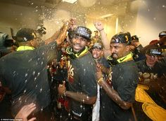 King James (centre) celebrates at Golden State Warriors' Oracle Arena in Oakland with his team-mates including Smith (right)