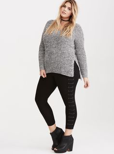 """These leggings have a major attitude problem (and we love it). The stretchy black knit fits you like a second skin - from stretch waistband, to tapered leg. The faux leather lace up sides spice up the look, lending some edge to your basics.<div><ul><li style=""""list-style-position: inside !important; list-style-type: disc !important"""">24"""" inseam</li><li style=""""list-style-position: inside !important; list-style-type: disc !important&qu..."""