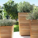 Teak Planters with plants on a patio, from Target - Modern Diy Wood Planters, Tall Planters, Tall Planter Boxes, Patio Planters, Privacy Planter, Concrete Planters, Garden Projects, Garden Furniture, Garden Inspiration