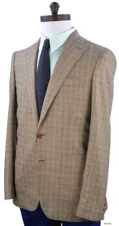 Luxire jacket constructed in brown houndstooth checks  Details    High gorge notch lapel and barchetta chest pocket.    Open front quarter with 2 button closure.    2 Hip patch pocket.  Natural shoulder shape and pick stitch on lapel, pockets and quarter.    Non-kissing 3 functional button cuffs with Milanese buttonhole.