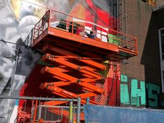 https://flic.kr/p/MF3jj9 | 2016.09 - Amsterdam photo of wall-painting artists in action in strong colors - NDSM-terrein in  Amsterdam-North - geotagged free urban picture in public domain / Commons; Dutch photography, Fons Heijnsbroek, The Netherlands | Amsterdam photo of wall-painting artists in action on a brick wall, with strong colors - at the NDSM-terrein in  Amsterdam-North. photo of September 2016. The industrial brick building blocks are built in the 1930's I think.  Urban…