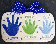 Carson in Dark Blue, Connor in Green, and Kyle in Baby Blue in this 3-Sibling Handprint Keepsake.