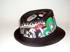 "Hand painted hat ""Rainbow""  A remarkable hand painted hat, with the theme ""Rainbow"".   The hat is brightly colored and have a modern designs.   The hat can be customized and painted on white or black backing.  Hats Material: Canvas"