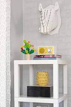 The $ 8 Room Makeover Secret — Young House Love bloggers show three innovative uses for Ikea's Lack side table (8 dollars each) — Three Tables as a Cube Bookcase