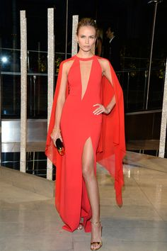Natasha Poly in a gorgeous red caped Michael Kors dress