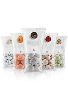 re-design of hatziyiannakis corporate identity as well as the packaging for a brand new product range, the 'pebbles': round candy with a core of juicy fruit or nuts & bitter chocolate covered with a thin sugar coating.  design credit, mouse graphics.  http://www.mousegraphics.gr