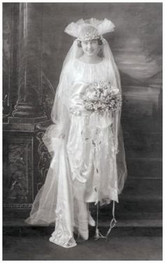 The bridal tulle headdress above has developed a pie-crust fan edge which gives an upward tilt to the face.  This style must have been welcome for many brides, who for more than a decade had little choice but to follow the prevailing cloche veil fashion.  The cloche veil dragged the hair flat and left the face devoid of uplift for the majority of brides.