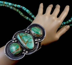 """THis is a PHENOMENAL Old Pawn vintage Navajo sterling silver bracelet featuring gloriously RUSTIC silver work and 3 Big & Beautiful Royston turquoise cabochons! About Old Pawn (or Dead Pawn""""): Technically, Old Pawn just means an item which has been pawned and let go (not paid for) by the owner. The Trading Post or Pawn Shop then resells the item to get their money back. People commonly associate old/dead pawn with vintage or antique Native American Indian jewelry. This is not always..."""